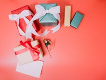 Group of present box and flower with wraping by shiny paper and Royalty Free Stock Photography