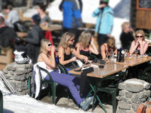 A group of pretty blonde women enjoy the sun Stock Image