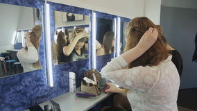 Group of pretty girls sits in front of mirror. stock video footage