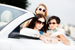 Group of pretty teenagers in the car Royalty Free Stock Photos