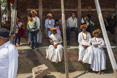 A group of priests have rest on footstep of temple , Dasain Festival , Kathmandu , Nepal. Dasain or Dashain is a 10 days festival in Nepal , and also is the stock image