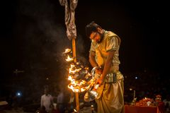 A group of priests perform Agni Pooja Sanskrit: Worship of Fire on Dashashwamedh Ghat - main and oldest ghat of Varanasi Royalty Free Stock Images