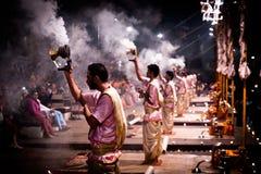 Group of priests performing Aarti - Hindu religious ritual of wo. Varanasi, India December 2, 2017: Aarti - Hindu religious ritual of worship performed at royalty free stock photo
