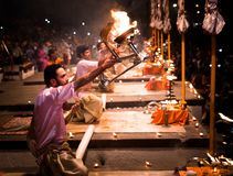 Group of priests performing Aarti - Hindu religious ritual of wo. Varanasi, India December 2, 2017: Aarti - Hindu religious ritual of worship performed at royalty free stock photography