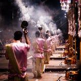 Group of priests performing Aarti - Hindu religious ritual of wo. Varanasi, India December 2, 2017: Aarti - Hindu religious ritual of worship performed at stock images