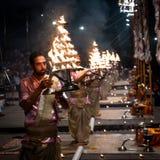 Group of priests performing Aarti - Hindu religious ritual of wo. Varanasi, India December 2, 2017: Aarti - Hindu religious ritual of worship performed at stock image