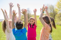 Group of child have fun on a field hand high. A Group of primary Pupils Outside Classroom Royalty Free Stock Photo
