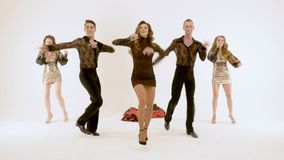 A group of professional actors dancing on a white background. A dancer in a short dress, very expressive dances. A group of professional actors dancing on a stock video footage
