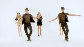 A group of professional actors dancing on a white background. slow motion. They make emotional movements. A group of professional actors dancing on a white stock video