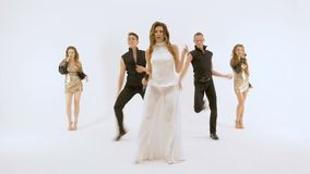 A group of professional actors dancing on a white background. They move synchronously, all movements are very plastic. Five people professional actors dancing on stock video