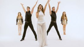 A group of professional actors dancing on a white background. They move synchronously, all movements are very plastic. Five people professional actors dancing on stock video footage
