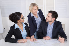 Group of a professional business team sitting at the table talking together. stock photos