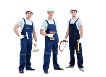 Group of professional industrial workers. Isolated over white background. Stock Image