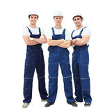 Group of professional industrial workers. Isolated over white background. Stock Images