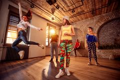 Professional people training modern dances in studio royalty free stock images