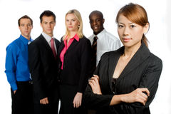 Group of Professionals. An attractive asian businesswoman and her team of professionals standing together on white background Royalty Free Stock Photo