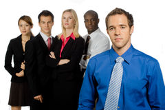Group of Professionals. An attractive caucasian businessman and his team of professionals standing together on white background Royalty Free Stock Images