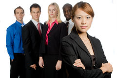Group of Professionals. An attractive asian businesswoman and her team of professionals standing together on white background Stock Images