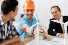 Group of project developers discussing wind turbine models Royalty Free Stock Image