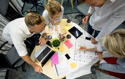 Group of project managers around the table. In creative office royalty free stock images