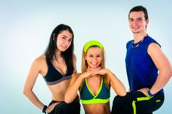 Group of proud fitness instructors. On white background Stock Photography