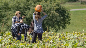 Group in a Pumpkin Patch. 25th Annual Pumpkin Festival, Christiansburg, VA – October 1st: A group of visitors in a pumpkin patch on Sinkland Farms at 25th Royalty Free Stock Photos
