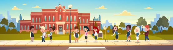 Group Of Pupils Mix Race Stand In Front Of School Building Primary Schoolchildren Talking Students. Flat Vector Illustration Stock Image