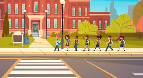 Group Of Pupils Mix Race Walking To School Building Primary Schoolchildren Students. Flat Vector Illustration Stock Photography