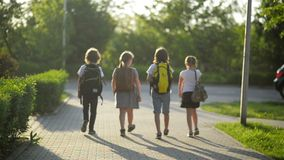 Group of Pupils with School Backpacks Are Going Back to School. They Are Having a Lot of Fun. stock footage