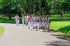 Group of pupils in a traditional school clothes on excursion in Stock Image