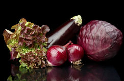 Group of purple vegetables on black Stock Photo