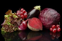 Group of purple vegetables and fruits on black Stock Photos
