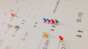 Group of push pins mark on white layout paper background Stock Images