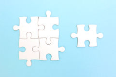 Group of puzzle and a puzzle piece. Teamwork concept. Royalty Free Stock Photos