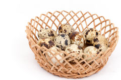 Group of quail eggs in the basket isolated over white background Stock Images