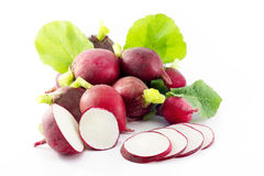 Group of radishes with the slices of radish. And leafs on a white background Stock Images