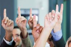 Group raising hands Royalty Free Stock Photos