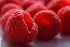 Group of raspberry with selective focus on one royalty free stock photos