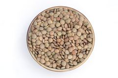 group of raw lentils in a bowl on white background royalty free stock photos