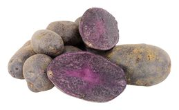 Group Of Raw Purple Majesty Potatoes. Isolated on a white background Royalty Free Stock Images