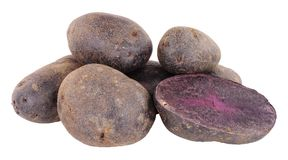 Group Of Raw Purple Majesty Potatoes. Isolated on a white background Stock Photo