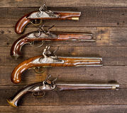 Group of Real Flintlock Pistols. stock images