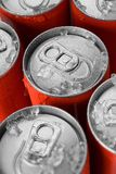 Red soda cans. Group of red aluminum soda or cola cans in ice with water droplets Royalty Free Stock Images