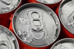 Red soda cans. Group of red aluminum soda or cola cans in ice with water droplets Royalty Free Stock Photo