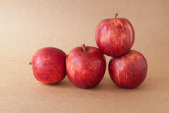 Group of red apples on brown paper background Stock Images