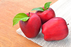 Group of red apples and green leaf Royalty Free Stock Photos