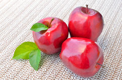 Group of red apples and green leaf Stock Images
