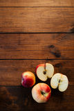 Group of red apples with a sliced one. Royalty Free Stock Images