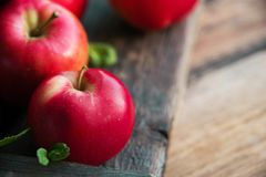 group of red apples on wooden natural background, fresh natural food and vitamins concept in rustic style Royalty Free Stock Photos