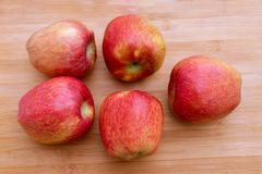 Group of red apples on wooden surface stock images